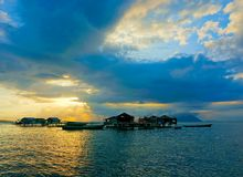 Beautiful sunset on ocean. With bajau floating house Stock Photography