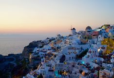 Beautiful Sunset in Oia, Santorini. Oia, pronounced Ia, is certainly the most beautiful and picturesque village of Santorini. It is known throughout the world stock photo