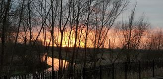 Beautiful sunset in Olney Milton keynes over the river Ouse with orange red and pink sky stock photography