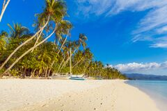 Free Beautiful Sunset On The Tropical Beach On Boracay Island, Philippines. Coconut Palm Trees, Sea, Sailboat And White Sand. Nature Royalty Free Stock Images - 188407839