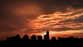 Sunset. Orange sky in the clouds. Silhouette of buildings. Beautiful sunset. Orange sky in the clouds. Silhouette of buildings royalty free stock image