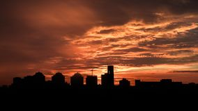 Sunset. Orange sky in the clouds. Silhouette of buildings. Beautiful sunset. Orange sky in the clouds. Silhouette of buildings stock images