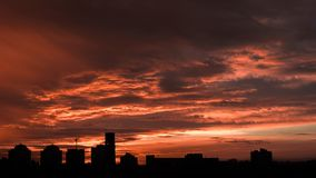 Sunset. Orange sky in the clouds. Silhouette of buildings. Beautiful sunset. Orange sky in the clouds. Silhouette of buildings royalty free stock photos
