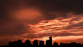 Sunset. Orange sky in the clouds. Silhouette of buildings. Beautiful sunset. Orange sky in the clouds. Silhouette of buildings stock image