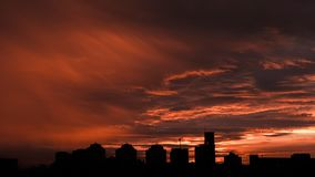 Sunset. Orange sky in the clouds. Silhouette of buildings. Beautiful sunset. Orange sky in the clouds. Silhouette of buildings stock photos