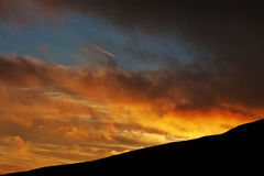 Beautiful sunset and orange sun lights above the mountains. Beautiful sunset and orange sun lights above the mountains stock photography