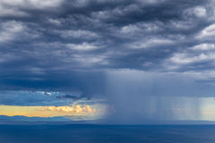 Beautiful sunset over Adriatic Sea, with beautiful dramatic cloudscape. Storm over Adriatic Sea, with beautiful dramatic cloudscape and rocky shore Stock Images