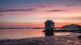 Beautiful sunset over Baltic sea near Gothenburg city, Sweden. W. Ooden house on the seacoast royalty free stock images