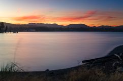 Beautiful Sunset over a Bay. Majestic Sunset over a Bay with Forested Mountains in Background. Sooke, Vancouver Island, BC, Canada royalty free stock images