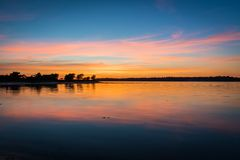 Beautiful sunset over bay with reflections. Beautiful vibrant colours on sunset over bay with reflections royalty free stock image