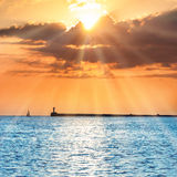 Beautiful sunset over blue sea Stock Images