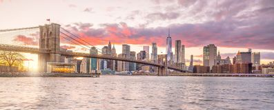 Beautiful sunset over brooklyn bridge in New York City royalty free stock photography