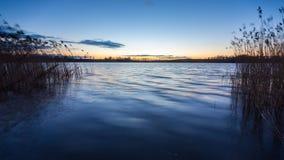 Beautiful sunset over calm lake Royalty Free Stock Photos