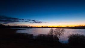 Beautiful sunset over calm lake Stock Photography
