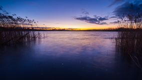 Beautiful sunset over calm lake Royalty Free Stock Images