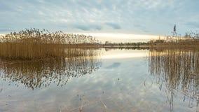 Beautiful sunset over calm lake Stock Image
