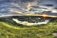 Beautiful sunset over city. Fisheye. Beautiful sunset over city with reflections in the river. HDR technique Stock Photos