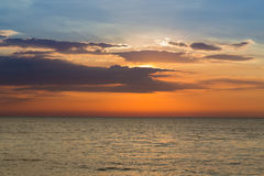 Beautiful sunset over coastline. Natural landscape background Stock Photos