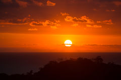 Beautiful sunset over Costa Rica. Red sky. Full disk sun Stock Images