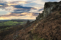 Beautiful sunset over Curbar Edge in Peak District National Park. Beautiful sunset landscape over Curbar Edge in Peak District National Park Stock Image