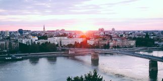 Beautiful sunset over Danube river and Novi Sad City with rainbow bridge Royalty Free Stock Photo