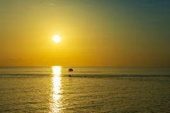 Beautiful sunset over dark sea. Summer background royalty free stock photography