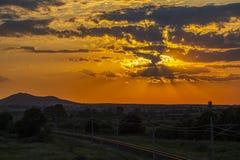 Beautiful sunset over empty railway tracks stock photo