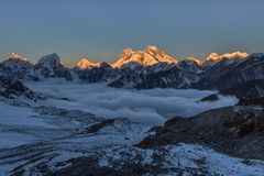 Beautiful sunset over Everest summit, view from. Beautiful sunset over Everest summit, view from Renjo La pass. Fabulous photo royalty free stock images