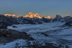 Beautiful sunset over Everest summit, view from. Beautiful sunset over Everest summit, view from Renjo La pass. Amazing view of mountain valley covered with stock photo