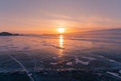 Beautiful sunset over freezing Baikal water lake. In winter season Russia Royalty Free Stock Photos