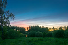 Beautiful sunset over green forest. Stock Photo
