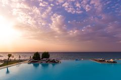 Beautiful sunset over an infinit pool and the Mediteraneean Sea in the Ixia gulf, on the western coast of the Rhodos island, near. The Rhodos city stock images