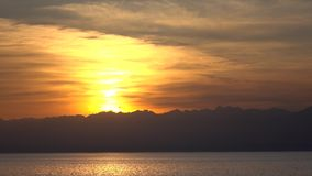 Beautiful sunset over Issyk Kul lake in Kyrgyzstan and distant ridge line 4K stock video footage