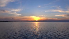 Beautiful sunset over Issyk Kul lake in Kyrgyzstan and ridge line 4K time lapse stock video footage