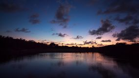 Beautiful sunset over the lake at a beach resort in tropics stock video