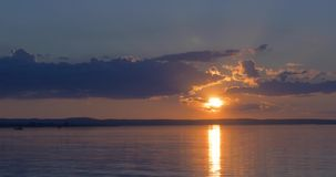 Beautiful sunset over of a lake stock footage