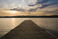 Beautiful sunset over lake landscape with jetty Stock Image