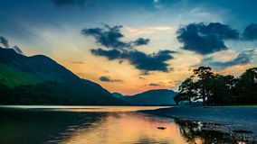 Beautiful sunset over the lake and mountains in the Lake District in the UK stock video footage