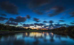 Beautiful sunset over the lake near the golf course in a tropica Stock Photo
