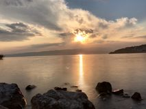 Beautiful sunset over lake ohrid. Beautiful double  exposure of sunset over lake ohrid in late July royalty free stock image