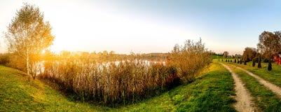 Beautiful sunset over the lake. Panoramic view Stock Image