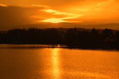 Beautiful sunset over the lake. Panoramic view. Royalty Free Stock Photo