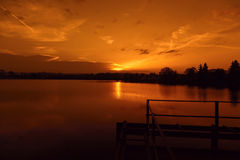 Beautiful sunset over the lake. Panoramic view. Royalty Free Stock Photos