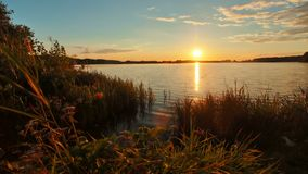 Sunset over lake in Russia. Beautiful sunset over lake in Russia stock video