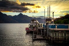 Beautiful sunset over lake Wakatipu in Queenstown, New Zealand stock photos