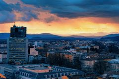 Beautiful sunset over Ljubljana old city and business downtown skyscrapers. Beautiful sunset over Ljubljana old city and business downtown center with royalty free stock photos