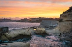 Beautiful sunset over Maltese Islands. Sliema shoreline with Fort Manoel at beautiful sunset. Malta Royalty Free Stock Photo
