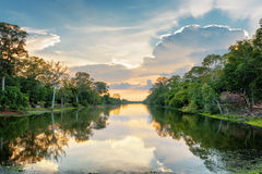 Beautiful sunset over moat surrounding Angkor Thom, Cambodia Royalty Free Stock Photography
