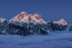 Beautiful sunset over mount Everest summit. Beautiful sunset over mount Everest summit colored in amazing gradient of pink and violet, view from Renjo La pass stock photos