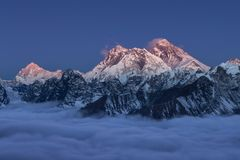 Beautiful sunset over mount Everest summit. Beautiful sunset over mount Everest summit colored in amazing gradient of pink and violet, view from Renjo La pass stock image